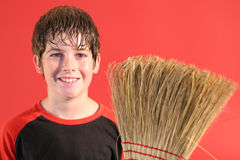 Happy boy with broom Royalty Free Stock Images