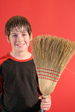 Happy boy with broom vertical Royalty Free Stock Photo