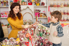 Happy boy buying sweets in the store Royalty Free Stock Photography