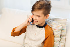 Happy boy calling on smartphone at home Royalty Free Stock Image