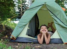 Happy boy in camping tent Royalty Free Stock Images