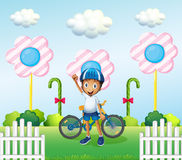 A happy boy at the candyland with his bike Stock Photo
