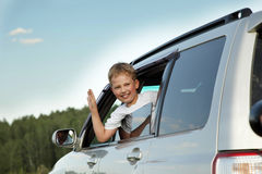 Happy boy in car stock image