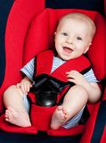Happy boy in car seat Royalty Free Stock Images