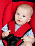Happy boy in car seat Stock Image