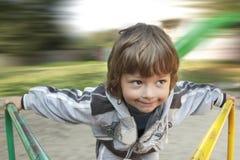 Happy boy on carousel Royalty Free Stock Image