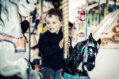 Happy Boy on a Carousel Horse Royalty Free Stock Photography