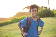 Happy boy carrying bagpack smiling. Portrait of happy boy carrying bagpack smiling Stock Photos