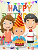 Happy boy cartoon blowing birthday candles with his family Stock Photo