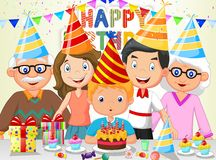 Happy boy cartoon blowing birthday candles with his family Royalty Free Stock Photos