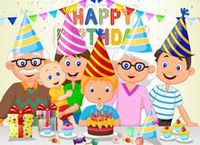 Happy boy cartoon blowing birthday candles with his family Royalty Free Stock Photography