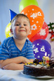 Happy boy celebrate birthday. Happy boy with a birthday cake Royalty Free Stock Photo