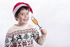 Merry Christmas. Happy boy celebrating christmas on white background royalty free stock photography