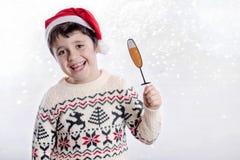 Merry Christmas. Happy boy celebrating christmas on white background royalty free stock images