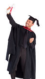 Happy boy celebrating with success his graduation Royalty Free Stock Images