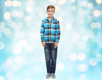 Happy boy in checkered shirt and jeans over lights Stock Photo