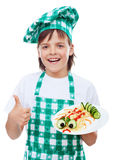 Happy boy chef with creative pasta dish Stock Photos