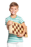 Boy with chessboard Royalty Free Stock Photography