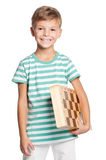 Happy boy with chessboard Royalty Free Stock Photos