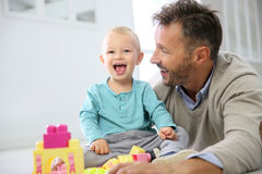 Happy boy child with his father playing together Stock Photo