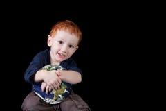 Happy boy child holding world environment stock images