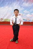 A happy boy on Children's Day. A student is performing on the stage on Children's Day in a primary school royalty free stock photography