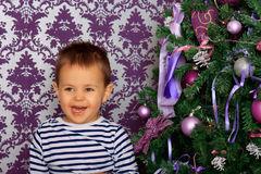 Happy boy in a Christmas atmosphere. In lilac tones Stock Photo