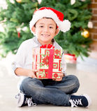 Happy boy with a Christmas gift Stock Photo