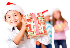 Happy boy with a Christmas gift Stock Images
