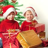 Happy boy with christmas gift near Christmas tree.  stock images