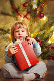 Happy boy with christmas gift Stock Image