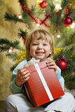 Happy boy with christmas gift Royalty Free Stock Photo