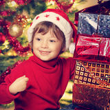 Happy boy with christmas gift Stock Photography