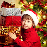 Happy boy with christmas gift. Near Christmas tree Royalty Free Stock Images