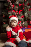 Happy boy with christmas gift. Near Christmas tree Stock Photo