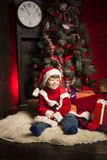Happy boy with christmas gift. Near Christmas tree Royalty Free Stock Photos