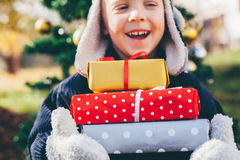 Happy boy with Christmas gifts Stock Photos