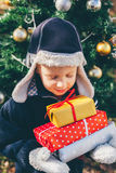 Happy boy with Christmas gifts Royalty Free Stock Image