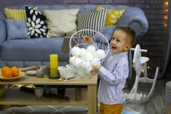 Happy boy in Christmas is playing with basket with fake snow stock photos