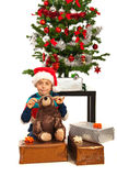Happy boy with Christmas presents Royalty Free Stock Image
