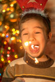 Happy boy with Christmas sparklers Stock Photo