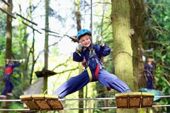 Happy boy climbing in adventure park Royalty Free Stock Images