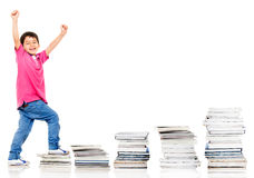 Happy boy climbing in his education Royalty Free Stock Images
