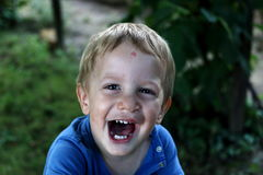 Happy boy with clip left Royalty Free Stock Photography