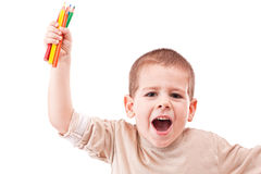 Happy boy with color pencils Stock Image