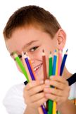 Happy boy with color pencils Royalty Free Stock Images