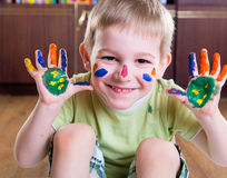 Happy boy with colorful  painted hands. Portrait of cute happy boy with colorful  painted hands Royalty Free Stock Photography