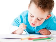 Happy boy coloring Stock Photography
