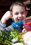 Happy boy colouring easter eggs Royalty Free Stock Photo