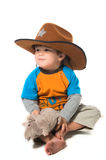Happy boy in cowboy hat Stock Photos